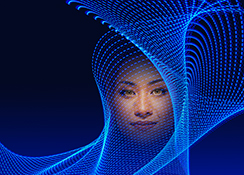 A woman's face appears in a complex network of blue lines in a stock photo about virtual reality, technology and the future.