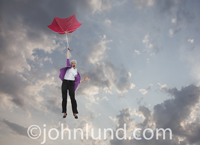 This retirement investment picture of a senior woman falling through the sky holding an inverted umbrella is about losing your retirement savings and investments.