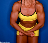 Photo of a woman body builder's torso and arms as she flexes her arms. This woman has big muscles.