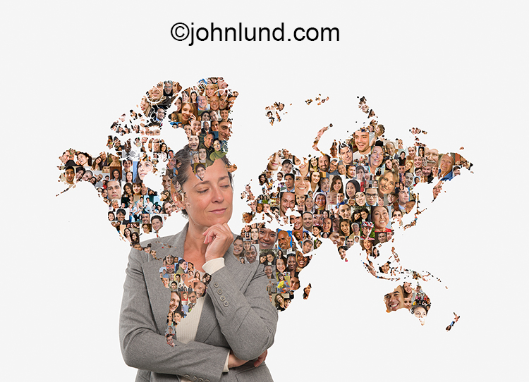 Social media for business is illustrated in this stock photo of a business woman examining a map of the world continents formed from social media portraits.