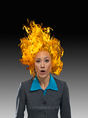 In this Internet Meme a woman wears a look of astonishment with her hair on fire...a strong indicator of extreme urgency!