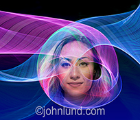 A woman's face appears in a complex network of colored light trails representing a hologram, future communications technology, and connections.