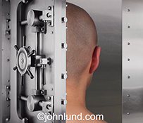 The issues of security, privacy and the mind are addressed in this stock photo of the back of a person's head within the confines of a bank vault.