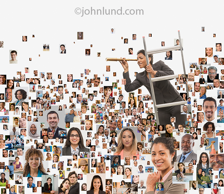 A woman, perched on a ladder in a sea of social media portraits, searches with a telescope in a stock photo about social networking, online searches and networked connections.