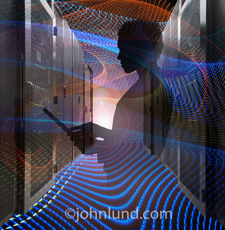 A server room, streaking light trails, and a woman using a mobile device are all combined in this composite image creating a stock photo about women in technology, IT and business in the digital age.