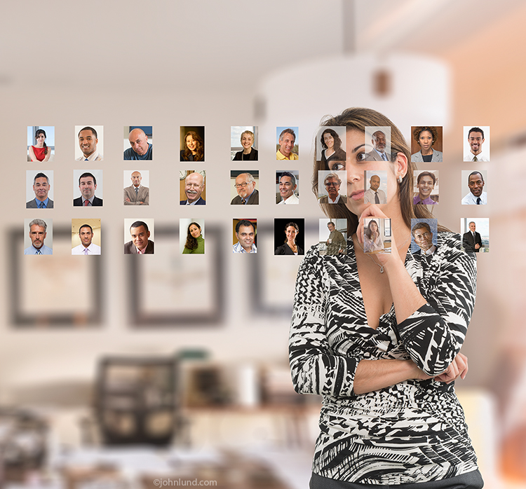 Online dating is the primary concept in this stock photo that shows a woman studying a series of portraits aligned before her in what appears to be new communications technology for dealing with social media and networking activities.