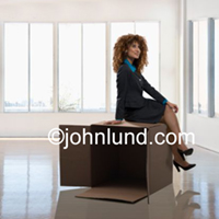 Photo of a woman sitting on top of a cardboard box in an office setting and thinking in an illustration of the classic