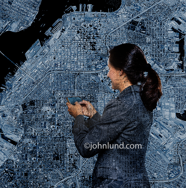 A woman uses a GPS against a background created from a satellite image of a large city in a stock photo about GPS issues and future technology.