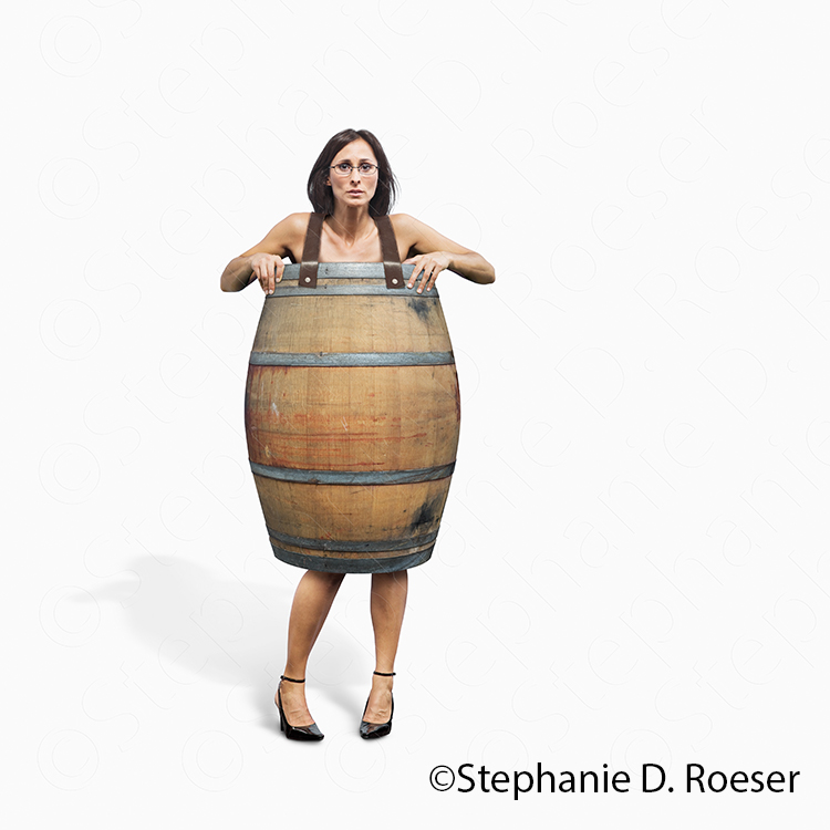 A bankrupt women stands on a white background wearing a barrel and nothing more in a stock photo about financial calamity, poverty and destitution.