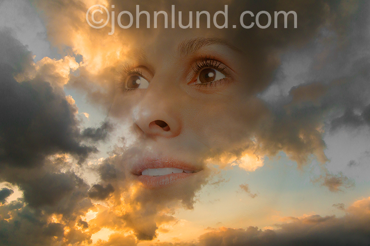 A beautiful woman's face is seen in the clouds of a sunset sky in a stock image about beauty, spirituality and the ethereal.