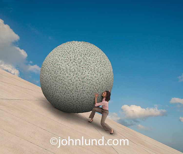 A woman pushes a hughe ball of money up a steep concrete incline in a Sysiphian investment task in this image about the challenges facing women investors.