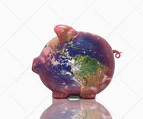 A piggy bank is superimposed with the earth in a stock photo about international and global investment, savings and banking.