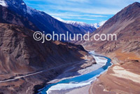 Beautiful Scenic Picture of the Zanskar river in the Himalayas. Camera is high above looking down on the rugged and foreboding territory.