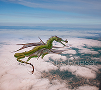 A dragon soars in flight over a city beneath scattered clouds in an image of fantasy, imagination and mystical powers.