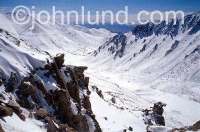 Picture of a beautiful scenic snow covered Himalayan pass. This view is just beyond the summit looking towards Leh.