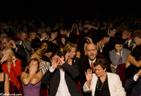 An audience is horrified in a theater and hiding their eyes except for one fascinated man in this funny picture.