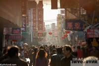 Stock photo of crowds of shoppers in Beijing China in a busy shopping district in the late afternoon light. Picture of Chinese Crowds.