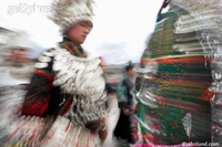 Chinese tribal dance and costumes stock photo. Motion blur and a slow shutter speed, combined with flash, add to the sense of motion and vitality.