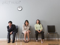 Three people looked bored while waiting endlessly in a waiting room. Ehtnic Business Men and Women waiting for an apointment or interview.