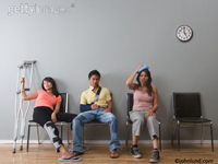 Funny stock photo of three injured people in a doctor's office waiting room. One has crutches, one an ice pack and one man has his arm in a sling.