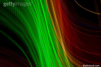Green and red lights stream across the frame in this abstract picture illustrating the theme of data transfer and communications technology.