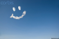 Picture of a smiley face composed of clouds and lending a cheery look to the deep blue sky.