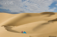 Senior woman with an active lifestyle as she stands next to her tent in the Gobi desert, Mongolia.