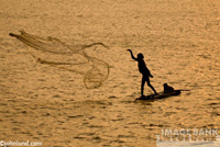 Lone Fisherman casts his net in this travel photo from India.