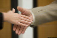 Picture of two hands about to seal a deal with a handshake. Pictures of hands in motion towards a handshake.