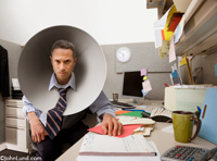 An angry and stressed businesman, in his cubicle, wears a dog cone around his neck to prevent him from abusing himself. Super funny pictures of people doing silly or dumb things. Funny cubical business pics.
