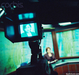 A news woman broadcasting from a Television news room