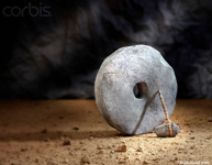 Picture of a stone ax and a large stone wheel representing early invention, creativity and innovation. Humor is added via the inference of a caveman.