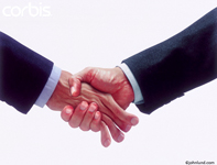 Photo of a funny handshake, an overly firm hand shake with one hand actually crushing the other; a parody of a strong handshake.