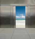 Elevator door opens to reveal a beach scene in this concept stock photo about a change of scenery, vacation and stress reduction.