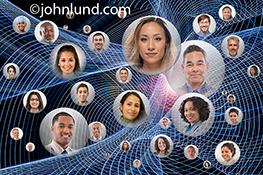 This social media network stock image features multiple portraits of people in orbs within a complex network of blue light trails.