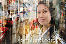 An Asian woman's face emerges from the hustle and bustle of Hong Kong commerce in this colorful photo.