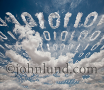 Data, ones and zeros, float through the sky in the form of clouds in a stock photo illustrating the concept of cloud computing.