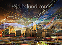 Picture of a city skyline with streaking lights portraying wireless communications, connections and streaming data.