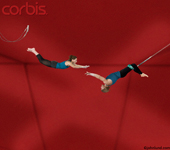 Pictures of flying trapeze artists caught just at the moment of the catch symbolizing teamwork, risk, co-operation and danger.