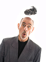 Photographer John Lund flips his wig in this humorous self portrait and stock photo.